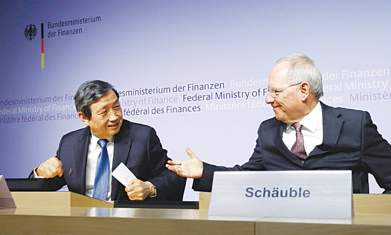 BERLIN: German Finance Minister Wolfgang Schaeuble and China's Vice Premier Ma Kai smile at their news conference here on Tuesday.—Reuters