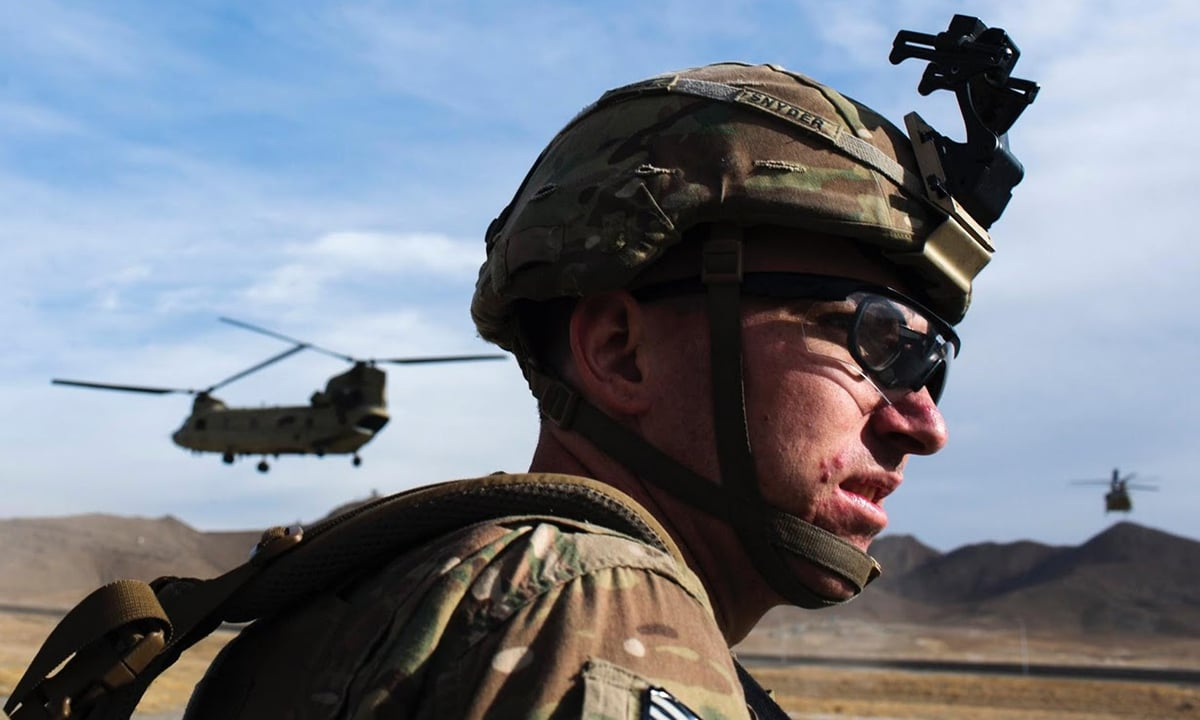 A US soldier waits for a helicopter to land after an advising mission at the Afghan National Army headquarters.
