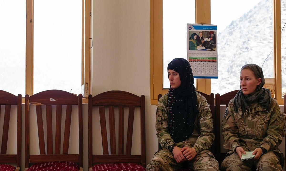 """Members of a US Army Female Engagement Team, Sergeant Shannon """"Nooria"""" Nastold (right) and Corporal Andrea """"Angela"""" Ekegren, discuss the state of health clinics at the Mara Wara district centre in Kunar Province."""
