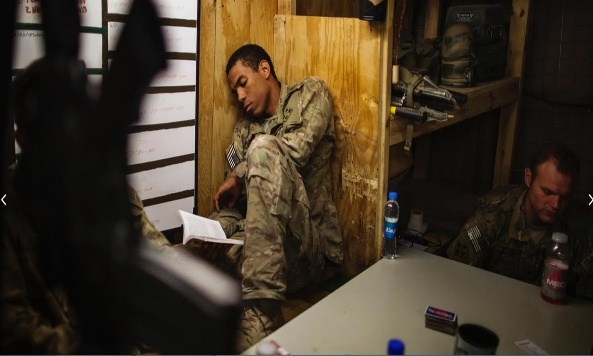 Private First Class Trent Pritchartt, and Specialist Ben Purvis (right) relax inside their bunker after firing a mortar at insurgent positions from inside Combat Outpost Nangalam.