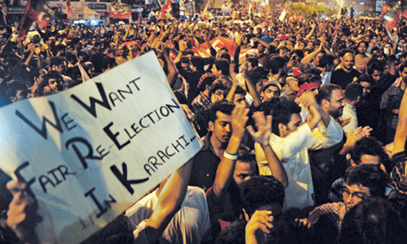 Dissatisfied voters protest for re-election in Karachi.