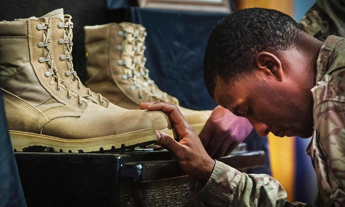 A US soldier pays his respects during a memorial for Martin and Morris.