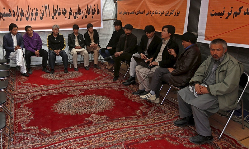 Ethnic Hazara demonstrators gather in a protest tent in Afghanistan's capital demanding action to rescue Hazaras kidnapped from a bus by masked men who many believe are influenced by Islamic State, in Kabul, March 19, 2015. — Reuters