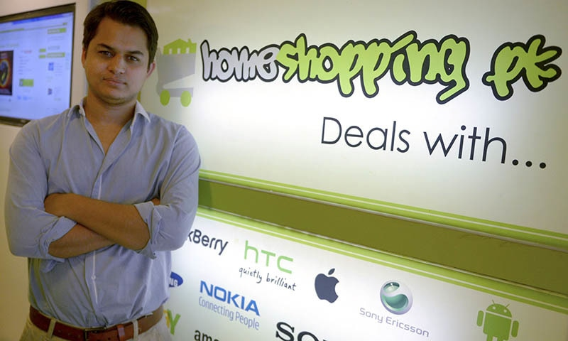 In this photograph taken on March 14, 2015, Shayaan Tahir, CEO of Homeshopping.pk, posing at his call centre in Karachi.  — AFP