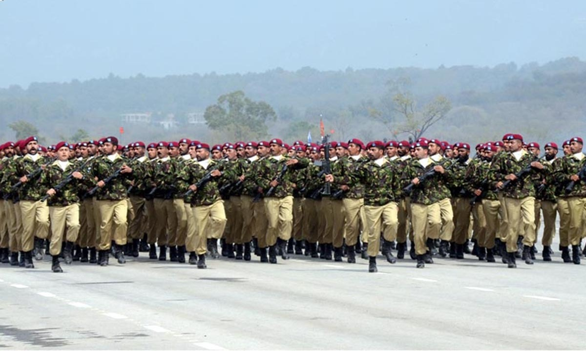 Personnel of Army SSG march-past during full dress rehearsal of Pakistan Day parade. — INP