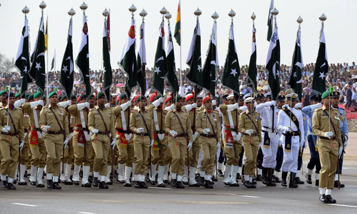 Armed forces personnel march-past during full dress rehearsal of Pakistan Day parade. — INP