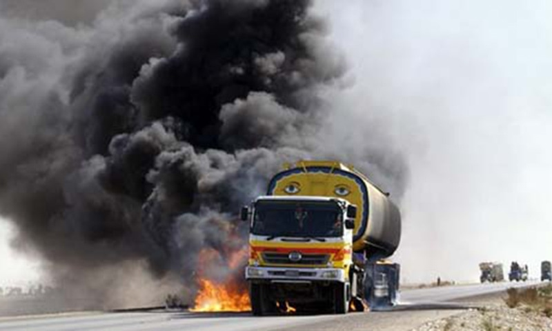 Smoke and flame rise from a burning oil tanker after a gunmen attack. — AFP/file