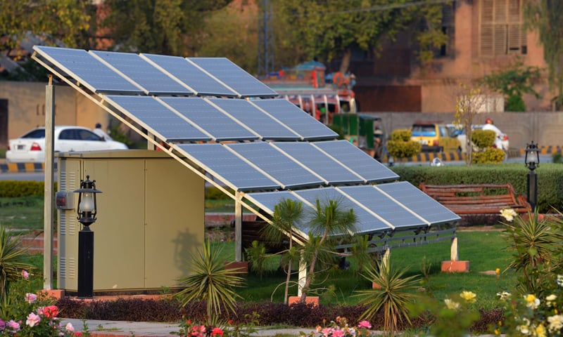 Solar panels installed at a park in Peshawar to meet lighting needs.—File