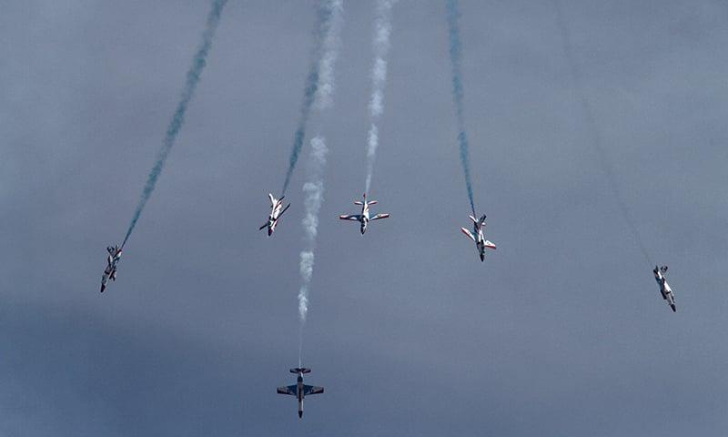 Sherdils demonstrate an aerobatic performance during the Pakistan National Day parade.—AP