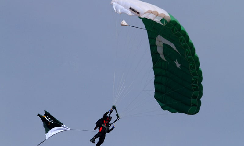 Para-trooper holding the national flag and wearing green jumpsuit 'landed beautifully'.—AP