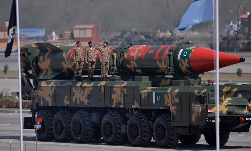 Soldiers stand beside long-range ballistic Shaheen II missile during the parade. —AFP
