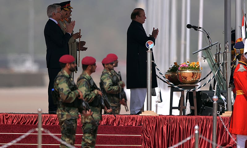 Prime Minister Nawaz Sharif watches the military parade in Islamabad. —AFP