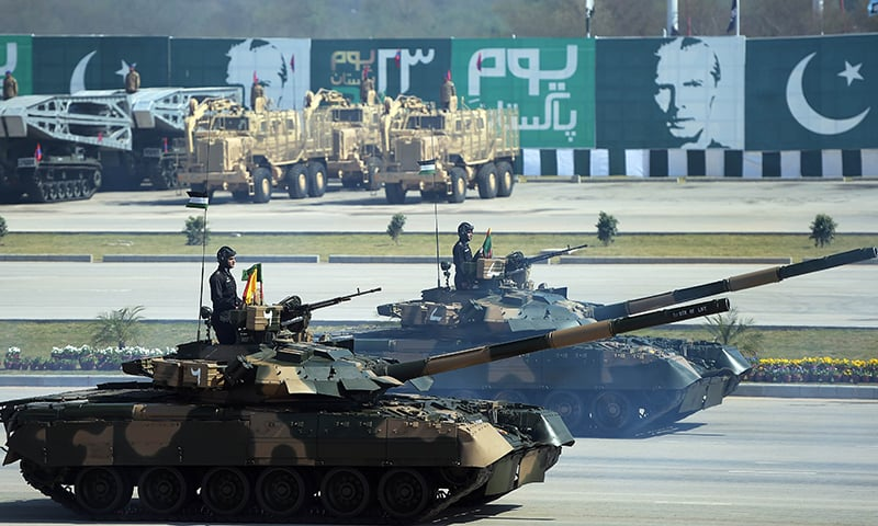 Troops ride Al-Zarar tanks during the military parade in Islamabad. —AFP