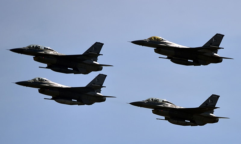 A view of the fly-past performed by Pakistan Air Force jets. —AFP
