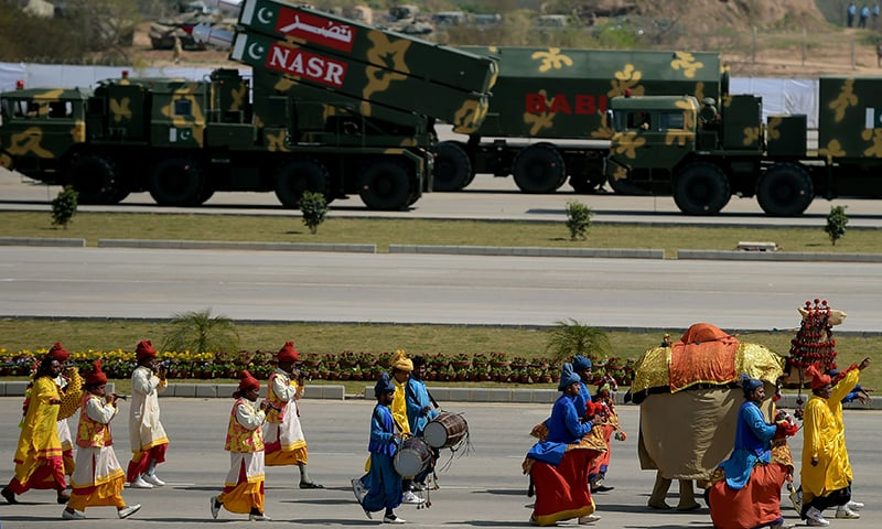 Folk artists perform during the military parade in Islamabad. —AFP