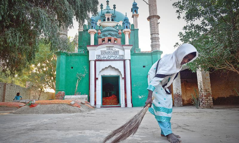 A WOMAN sweeps the floor of the 400-year-old mausoleum of Sohni in Shahdadpur, Sindh.—Fahim Siddiqi / White Star