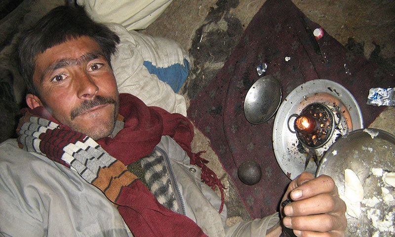 A man smokes opium. — Photo by author