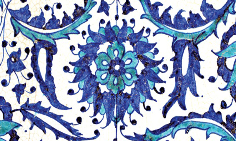 A floral blue and white ceramic tile inspired by Mughal art