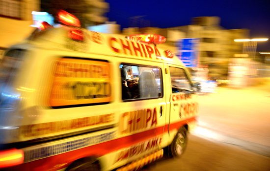 An ambulance rushing to an emergency site is pictured — Photo by White Star