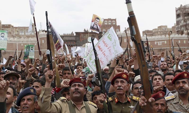 Shia rebels, known as Houthis, hold up their weapons to protest against Saudi-led airstrikes, during a rally in Sanaa, Yemen, Thursday, March 26, 2015. — AP