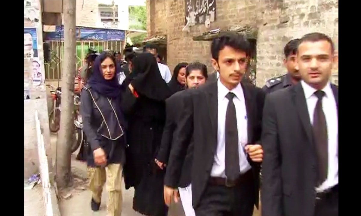 A burqa-clad Ayyan was accompanied by her lawyers and security personnel to the customs court. -DawnNews screengrab
