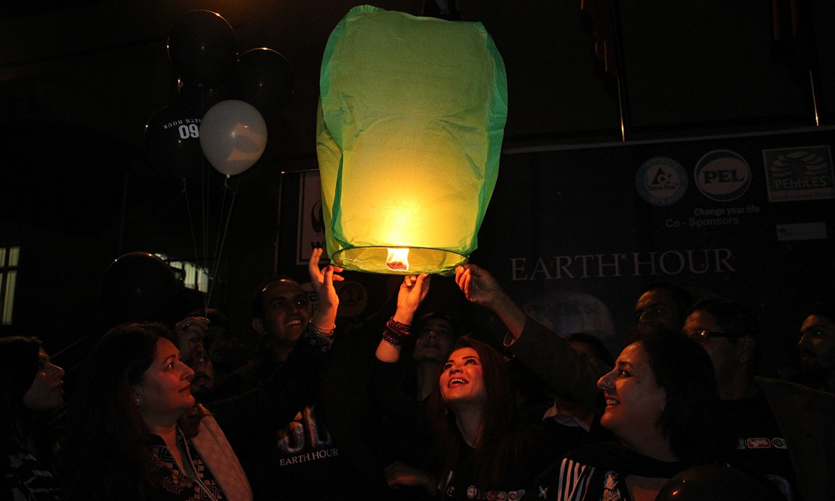Lanterns being released in the air during Earth Hour. — Courtesy Photo