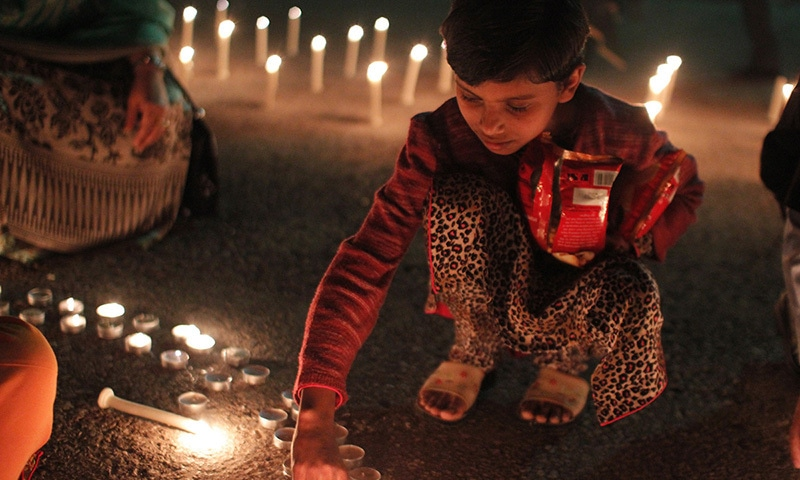 Children lighting candles in consonance with Earth Hour. -Courtesy Photo