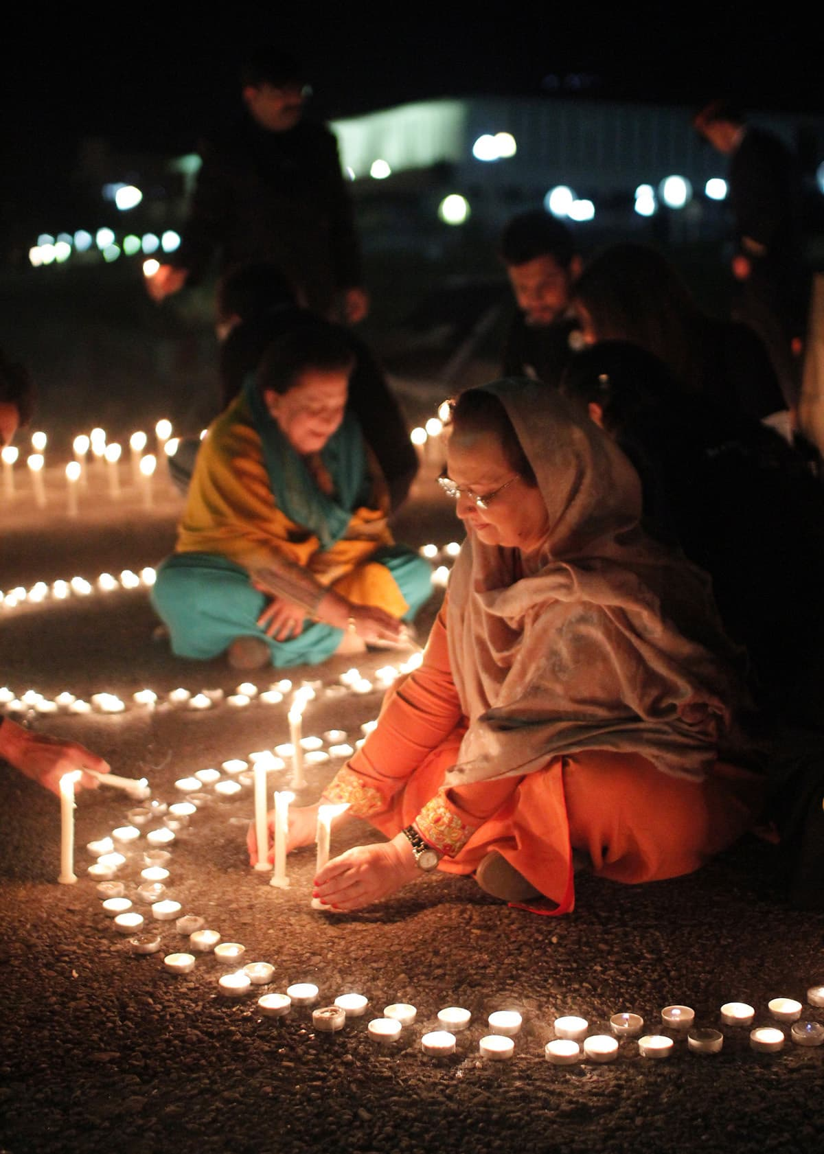 People actively participate in celebrating Earth Hour by lighting candles. — Courtesy Photo