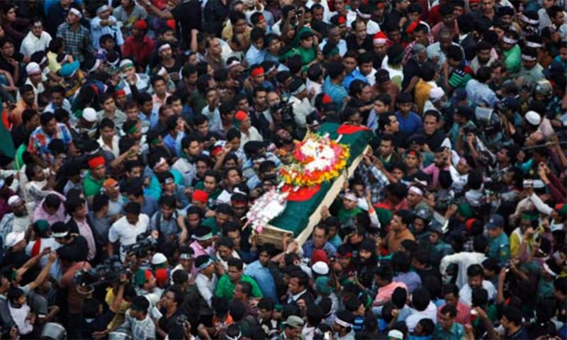 In this Feb. 16, 2013 file photo, Bangladeshi mourners carry the coffin containing the body of blogger Rajib Haider for funeral in Dhaka. ─ AP Photo/File