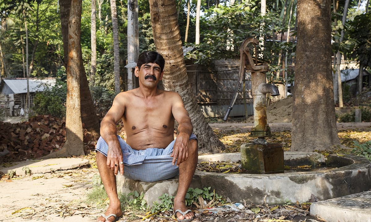 A villager sits besides a tube well, which was declared arsenic-contaminated. Most of the tube wells contain arsenic water in West Bengal.— Baba Tamim