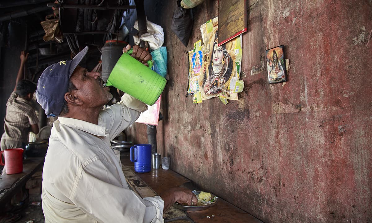 A man drinking water from a water jug at a roadside dhaba.  The new water-purifying plant is being seen as deterrent to Arsenicosis.— Baba Tamim