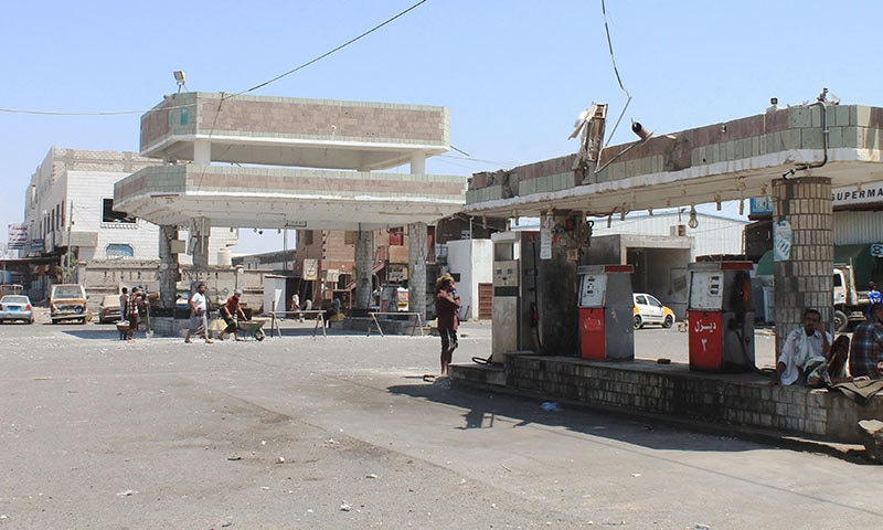 An image taken on March 29, 2015 shows a burnt petrol station in Yemen's second city of Aden. — AFP