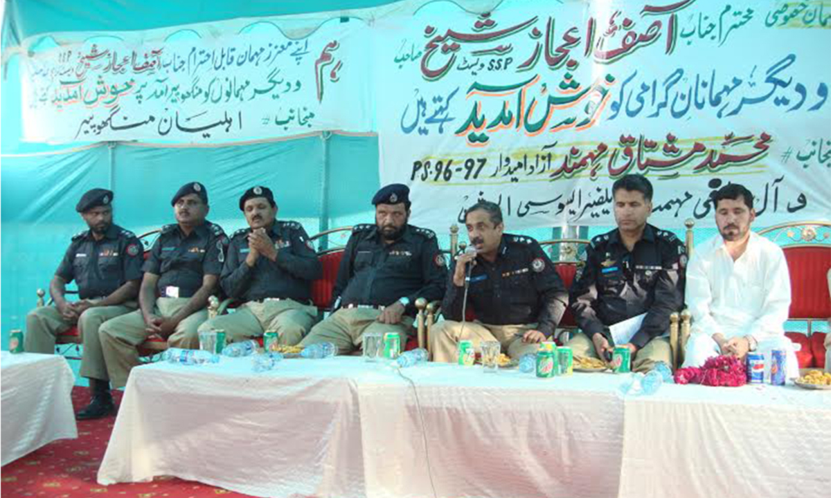 Mohammad Mushtaq Mohmand with police officials at a public gathering in Manghopir