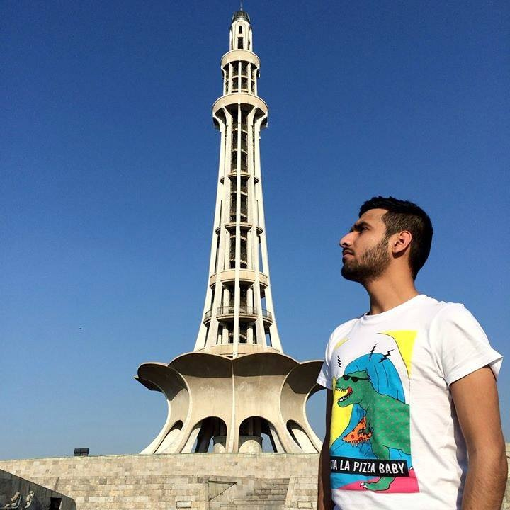 Zaid Ali stands in from of Minaar-e-Pakistan.— Photo courtesy: Zaid Ali's Facebook page