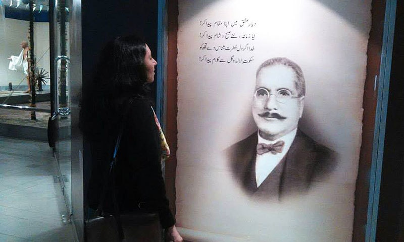 The author attempts to read Iqbal at the Pakistan Monument museum.
