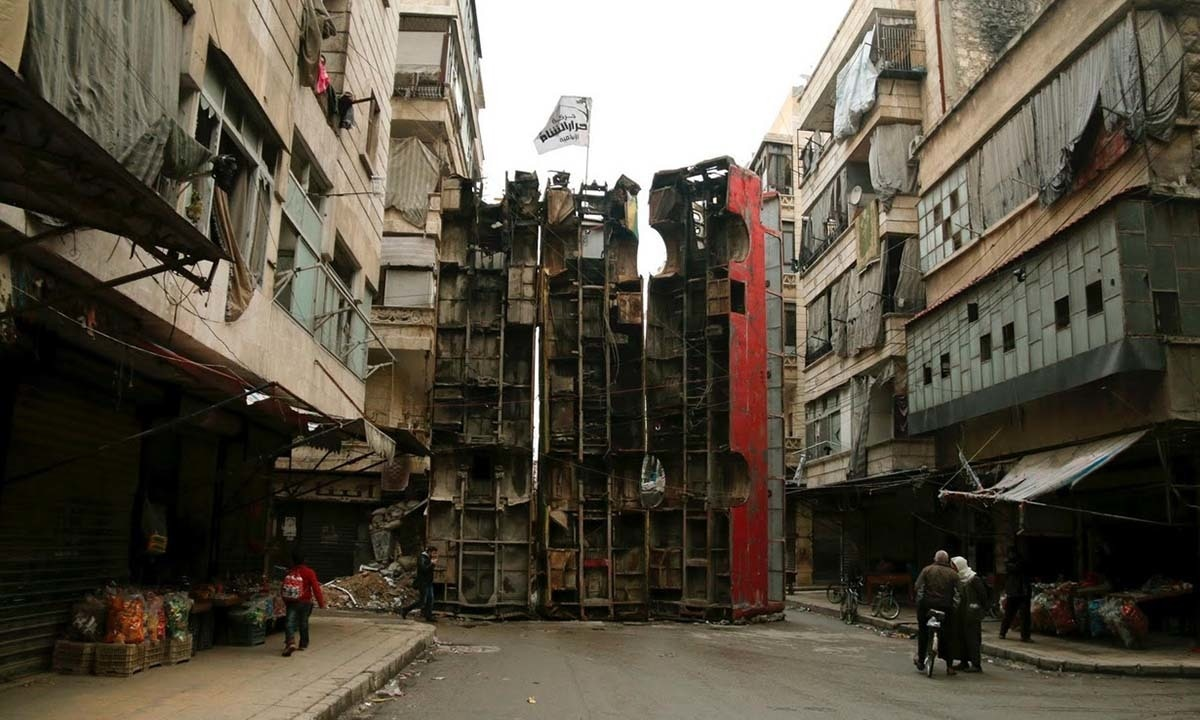 Upended buses barricade a street in Aleppo. The vehicles serve as protection against snipers loyal to Syria's President Bashar al-Assad, in the rebel-controlled Bustan al-Qasr neighbourhood.