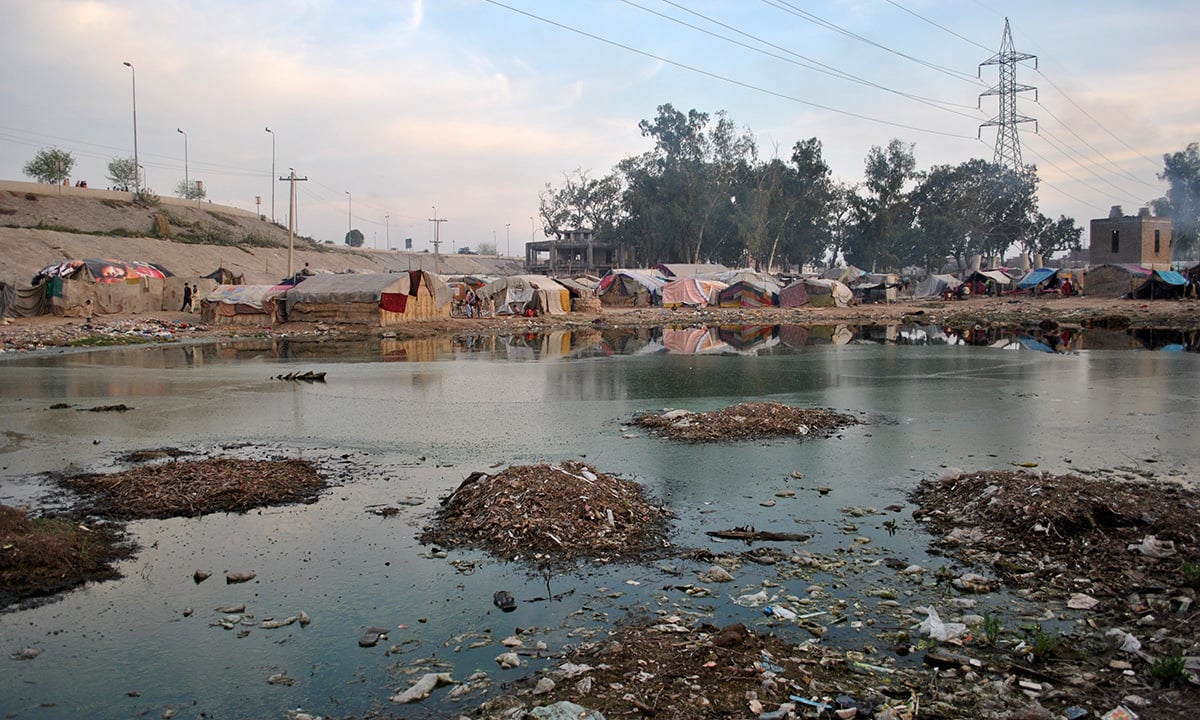 Cluster of about 400 tents along the bank of river Ravi, without any basic utilities like electricity and water.