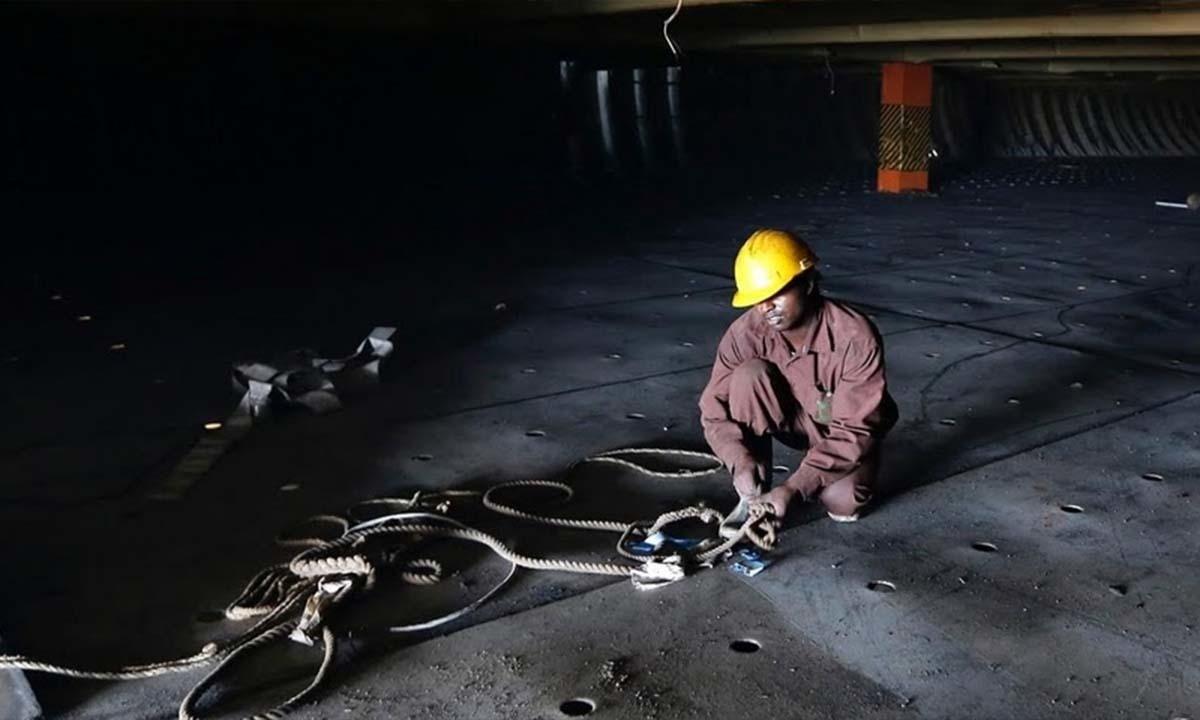 A worker dismantles a ship at the Alang yard.