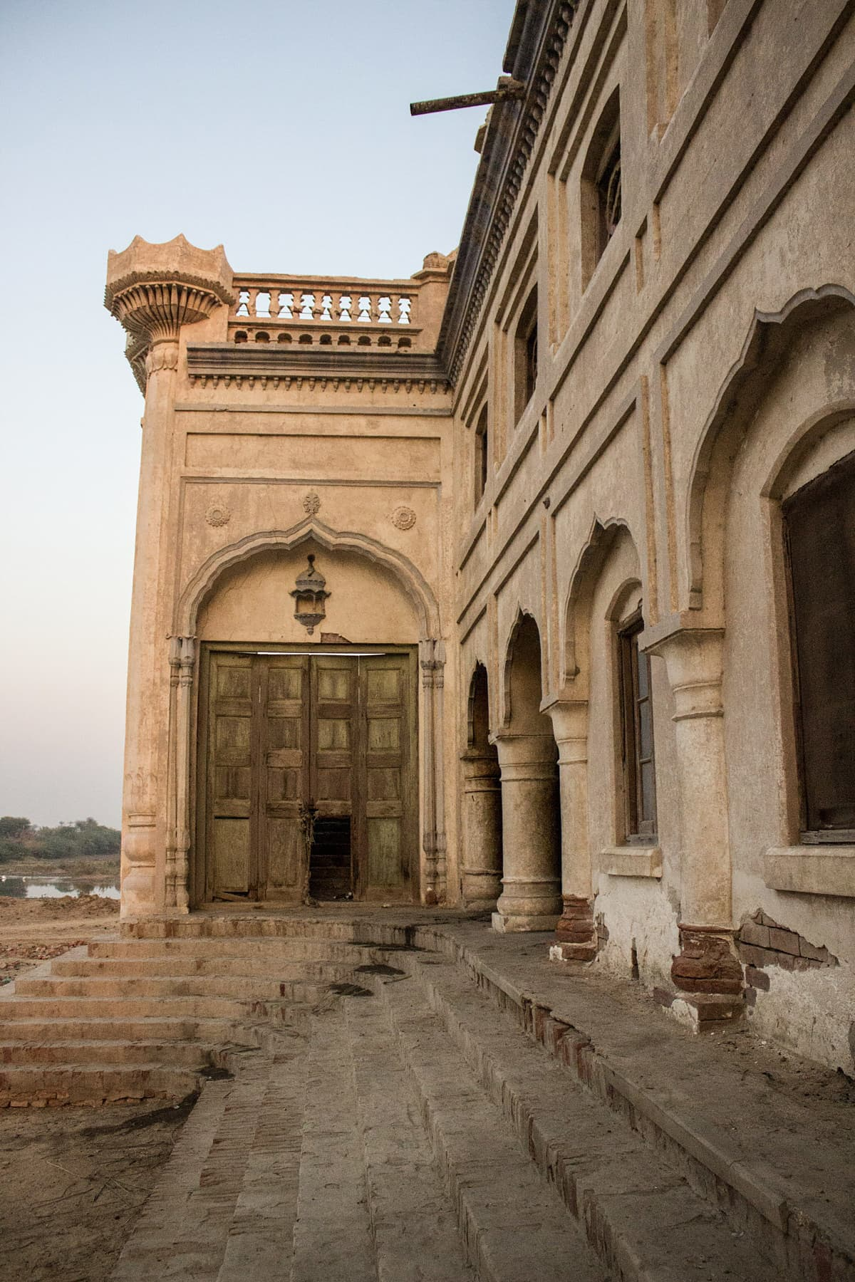 A green faded door at the side entrance of the Sheesh Mahal. Photo by Shameen Khan