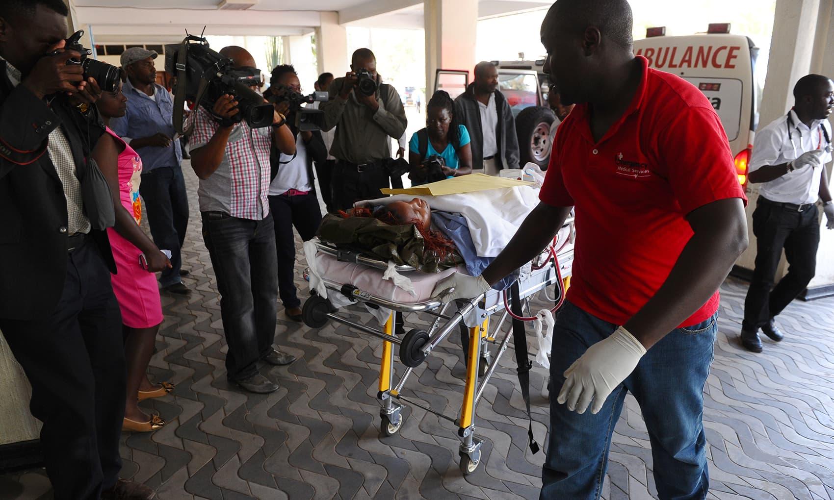 Medics help an injured person at Kenyatta National  Hospital in Nairobi, Kenya. -AP