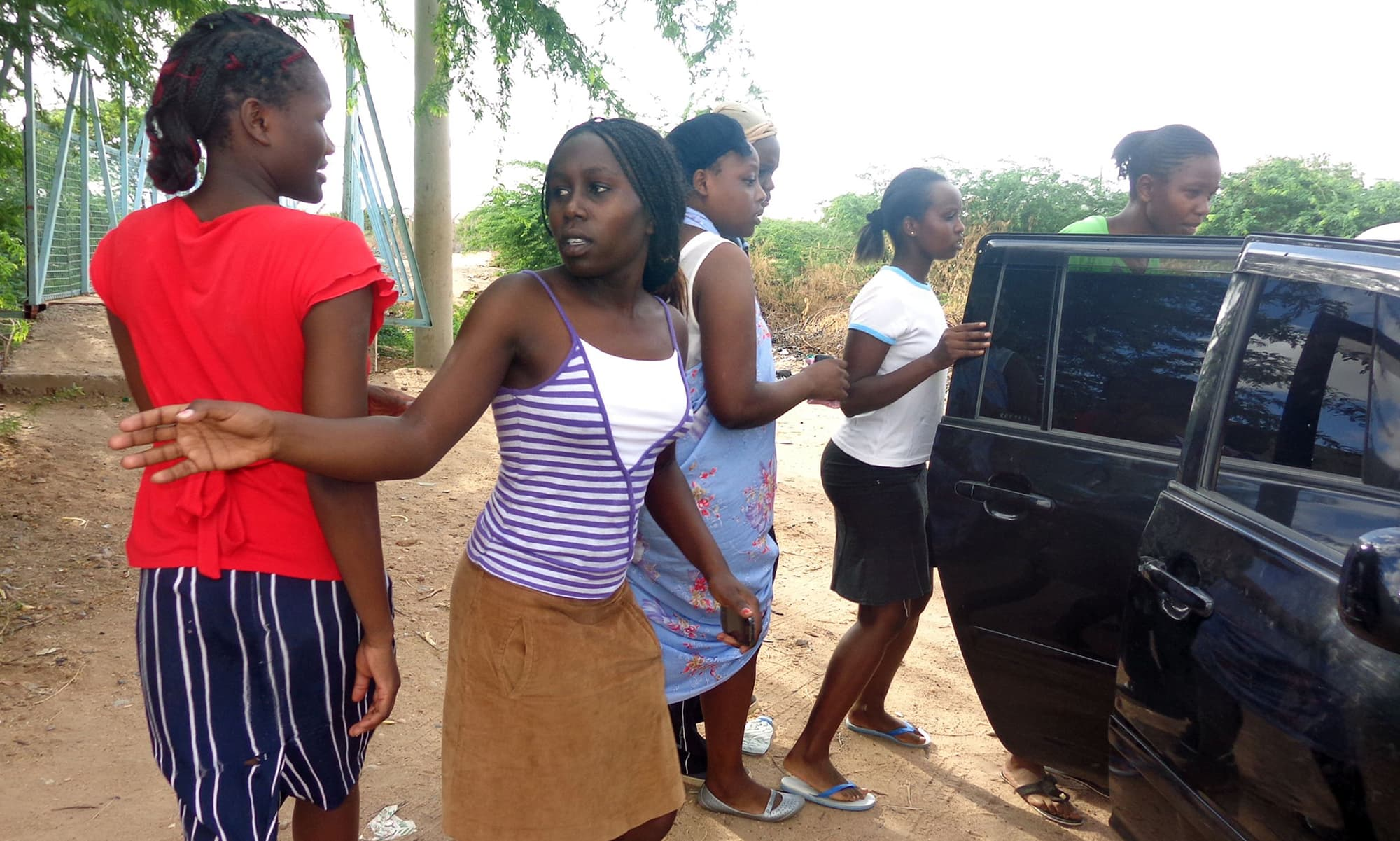 Students of the Moi University leave after escaping an attack. -AFP