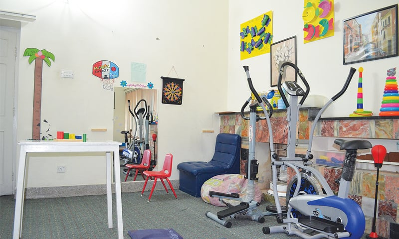 The occupational therapy room at Autism Resource Centre, Pindi, where autistic children are engaged in activity-based interactions.