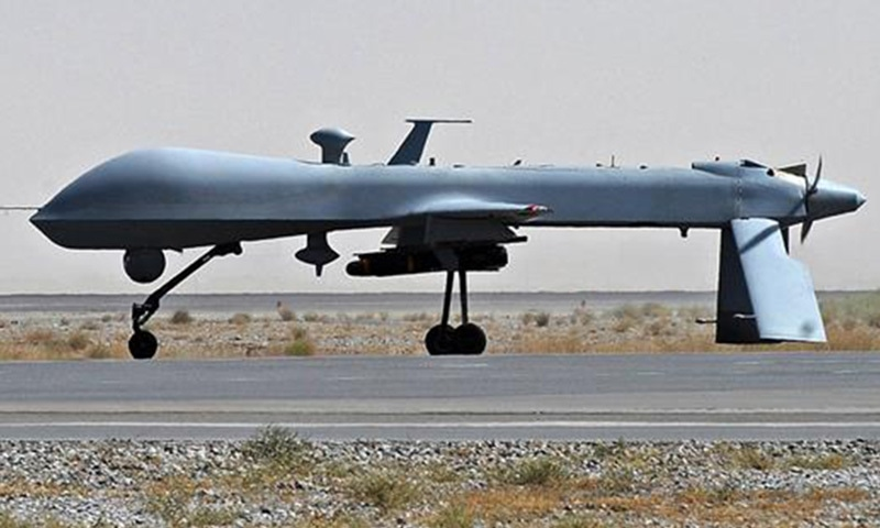 A US Predator unmanned drone armed with a missile on the tarmac of Kandahar military airport in Afghanistan. - AFP