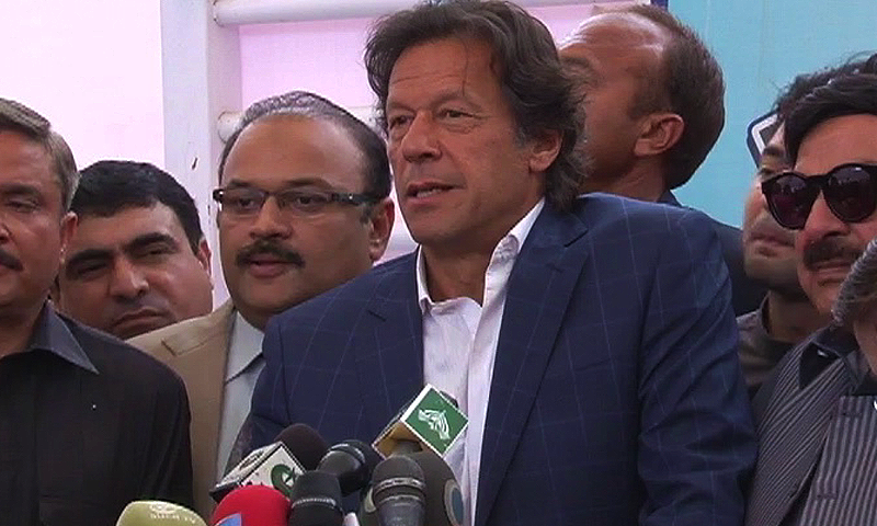 PTI Chairman Imran Khan talking to reporters after adjournment of joint session of Parliament. — DawnNews screengrab