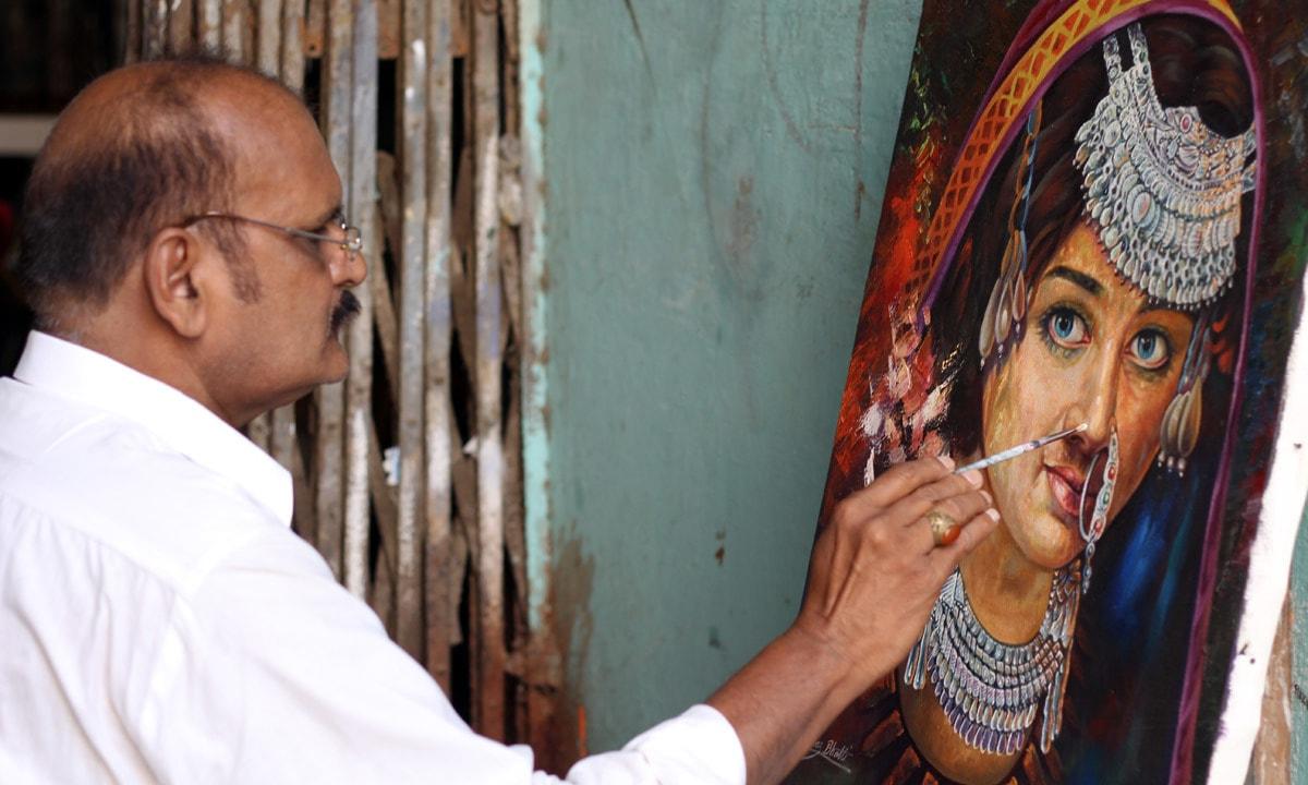Parvez making a potrait of a woman. — Yumna Rafi
