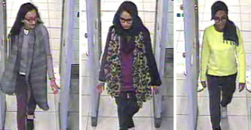 Amira (centre, circled), Kadiza Sultana (left), and Shamima Begum (right) pictured at Gatwick.—Photo courtesy: The Daily Mail