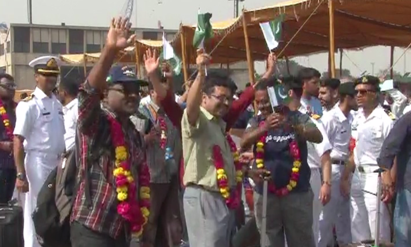 """The Pakistani evacuees upon returning waved flags and chanted """"Pakistan Zindabad"""" slogans. - DawnNews screen grab."""