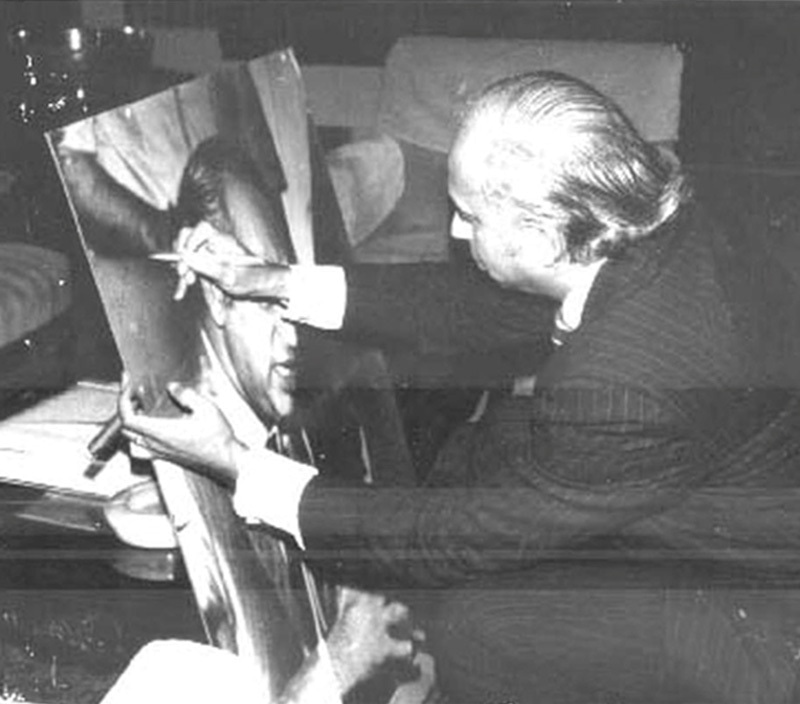 ZA Bhutto signing a portrait of himself in 1975. His populist regime (1971-77) tried to blend socialism with democratic populism and certain aspects of Political Islam. Under him, the Pakistan Ideology meant a national evolution towards creating a state and nation that was progressive and multicultural, driven by egalitarian notions of Islam and an aggressive stance against India. He was toppled in 1977 in a military coup and then hanged (through a controversial trial) in 1979.