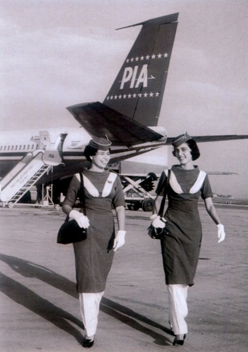 Walking tall: Stewardesses of Pakistan International Airline (PIA) on the runaway of Karachi Airport (in 1960). The uniforms of PIA hostesses were at the time designed by famous French designer, Pierre Cardin. PIA became one of the top 10 airlines of the world till it began its slow decline from the early 1980s onwards.