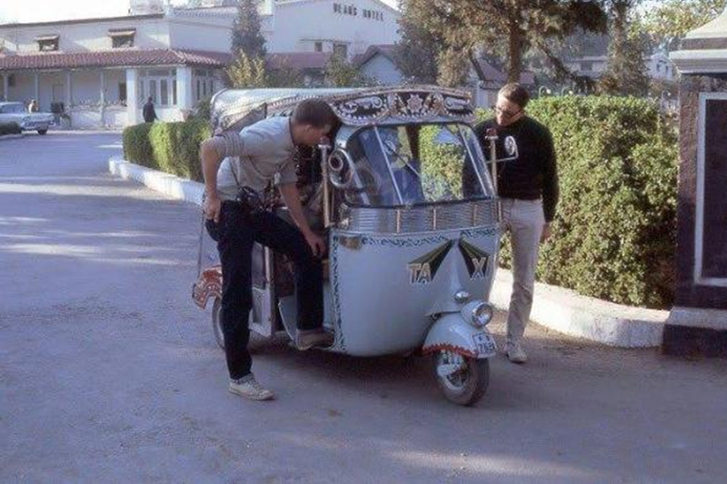 Gringo ride: American tourists bargaining with a Rickshaw driver outside Dean's Hotel in Peshawar in 1963.